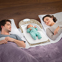 baby-delight-snuggle-nest-comfort-infant-sleeper-taupe-leaves-couple