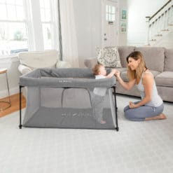 Mom and Baby in a Go With Me Nod Deluxe Portable Travel Crib