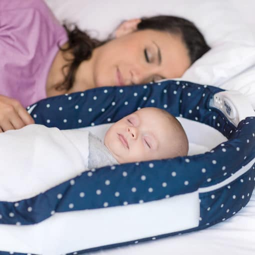 Mom and Baby sleeping with Baby Delight Navy Dots Snuggle Nest