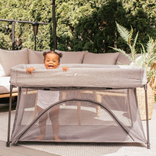 Baby in a Go With Me Nod Deluxe Portable Travel Crib