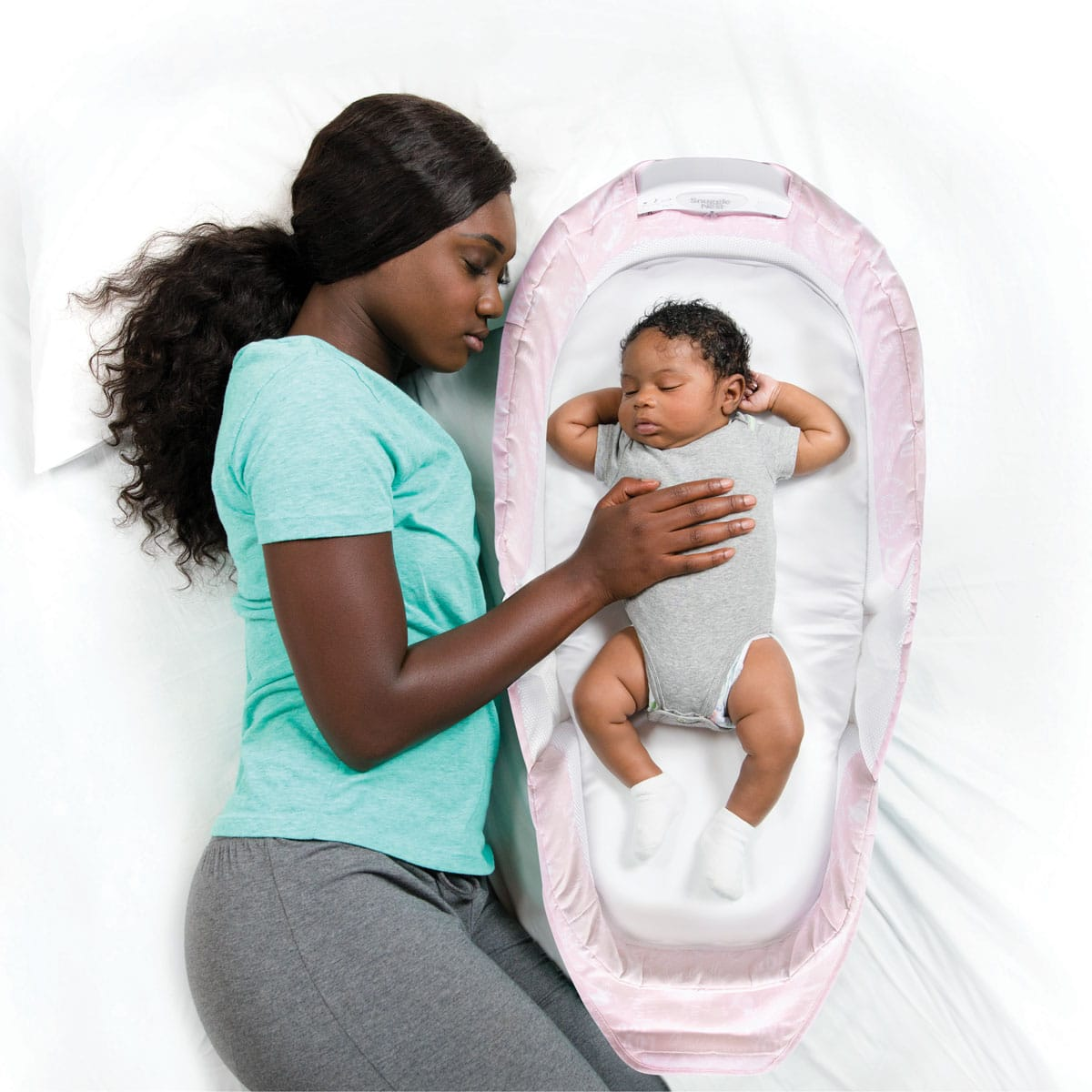 Mom and baby sleeping with baby delight pink baby love snuggle nest