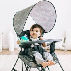 baby sitting in the go with me portable camo colored chair in bedroom