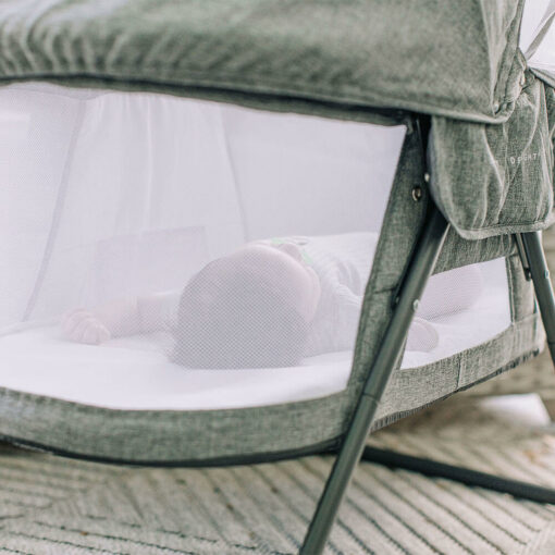 baby behind the mesh of the slumber bassinet