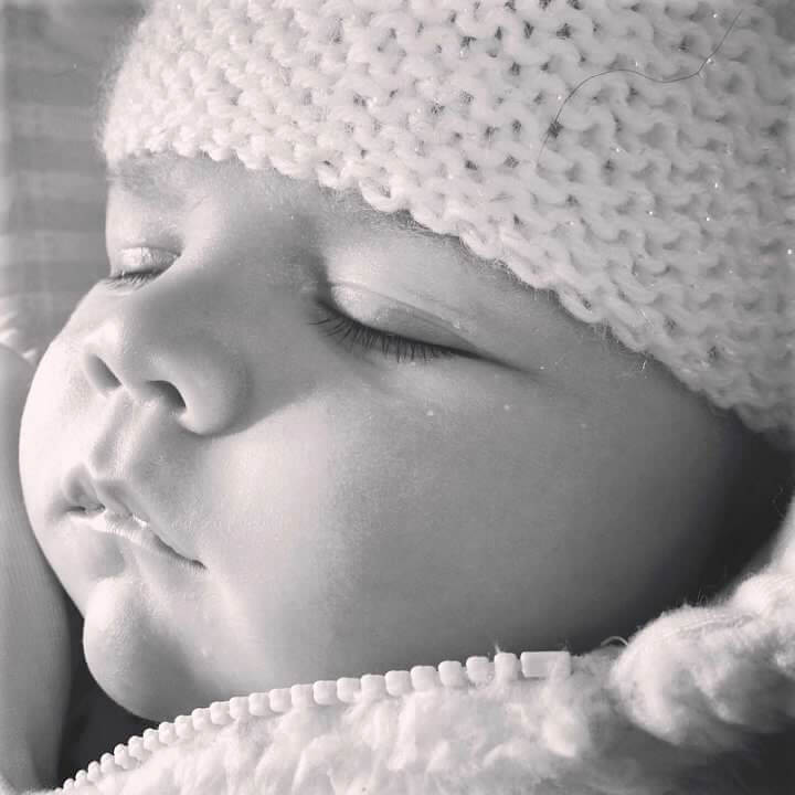 baby sleeping with knitted hat on
