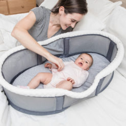 Snuggle Nest Peak Portable Bassinet with mom and baby