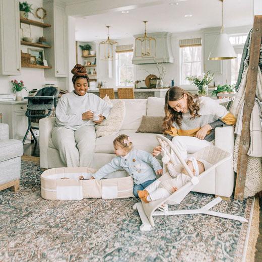 Moms and their babies hanging out in living room