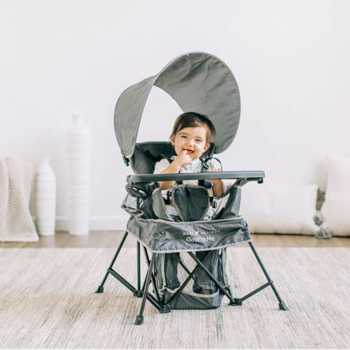 baby sitting inside the go with me portable grey chair