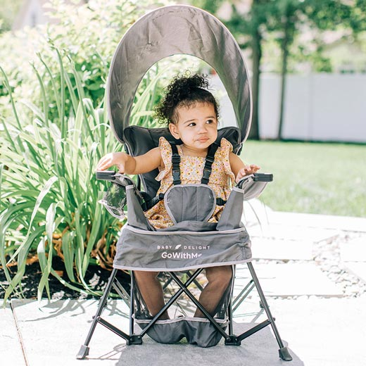 Toddler sitting in outdoor portable chair