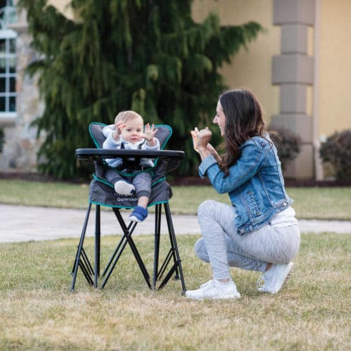go with me uplift portable high chair outside